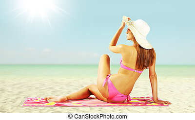Beautiful woman tans - Charming woman on the beach