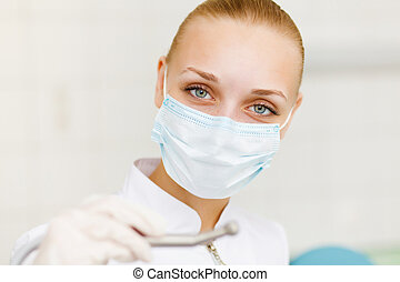 A portrait of a dental worker