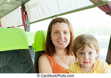 Mother and child traveling in autobus,