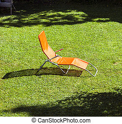 empty sun lounger in the garden