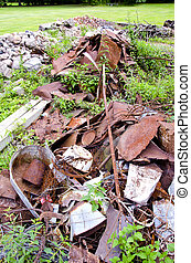 rusted scrap-iron on farm grass - rusted scrap-iron on farm...