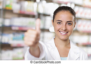 Portrait of Smiling Woman Pharmacist in Pharmacy - Smiling...