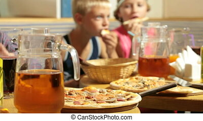 Eating Pizza in Restaurant - Children Eating Pizza in...