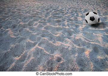 soccer football on sand beach
