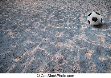 soccer football on sand beach