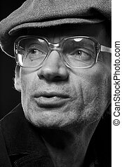 The black-and-white portrait of the elderly actor which is...