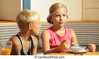 Little Couple at Fast Food - A boy with his little...