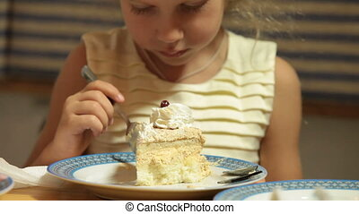Child Eating Cake - Little girl eating a piece of cake