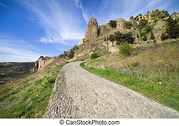 Rural Road in Andalusia Countryside - Rural cobbled road on...