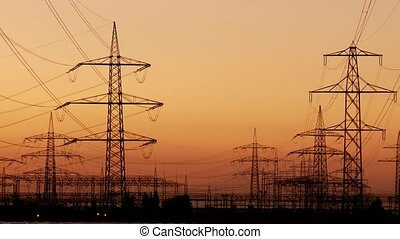 Electricity and Sunset - Power Poles With Sunset