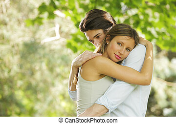 Romantic young couple - the romantic embrace of a young...