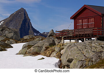 Mountain cabin on Lofoten islands in Norway with sharp...