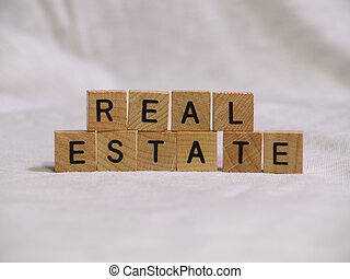 Block Real Estate - The words REAL ESTATE spelled out with...