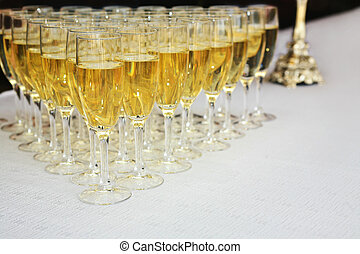 Champagne glasses on a table - Glasses filled with sparkling...