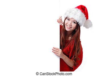 Christmas woman smile showing billboard - christmas young...