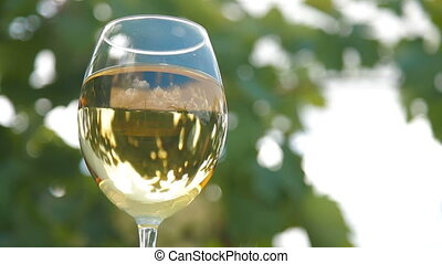 Blue Sky in Glass of Wine - Blue sky with clouds reflected...