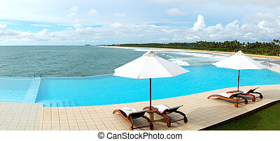 The panorama of the sea view swimming pool and beach,...