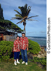 Bound for Island Lauau - Couple smile in their matching red...