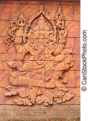 A stone carved sculpture statue of an Indian god.
