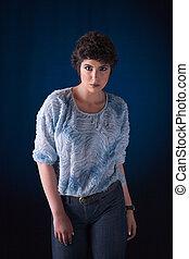 beautiful young woman, looking to camera, studio shot
