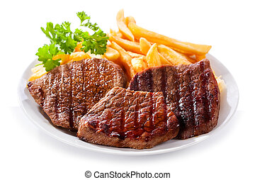 plate of grilled meat with frieis on white background