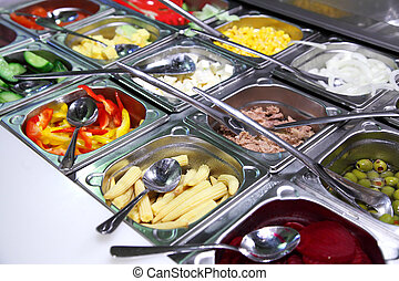 salad bar with vegetables in the restaurant