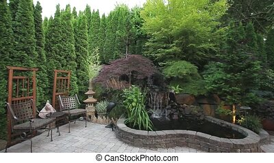 Paver Stone Backyard with Waterfall