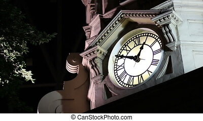 night clock tower 1am - A clock tower at night close 1 am...