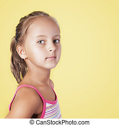 close up portrait of young beautiful little girl in front of...