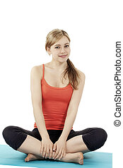 happy young fitness woman making a break in tailor-seat on white background