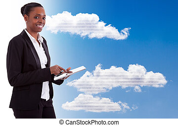 Smiling african american businesswoman using a tactile tablet