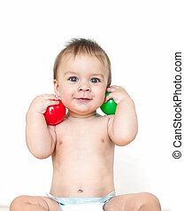 Little boy with a balls in a studio