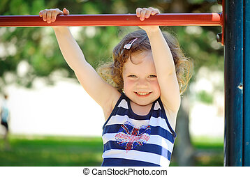 Little girl engage in gymnastic