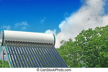 solar water heating system on the roof of a house on a...