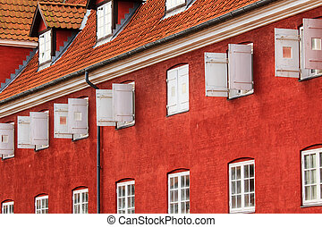Open and closed windows of a former prison in kastellet of...