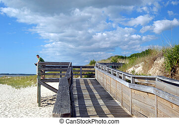 Along the Eastern Shore of Virginia - Young man stands...