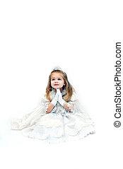 Angel in White - Little girl folds her hands in prayer. She...