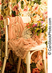elegant dress, frame and flowers on white chair