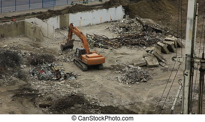 construction excavator - a heavy construction machine called...