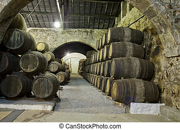 wine cellar - old cellar with rows of wooden barrels
