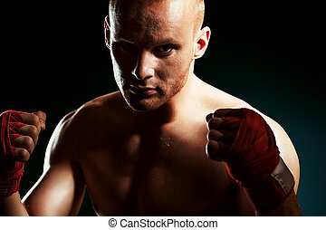 champion - Portrait of a muscular boxer in red gloves posing...