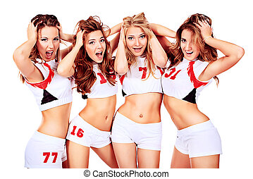 delighted girls - Group of professional cheerleaders posing...