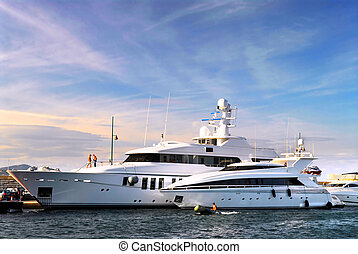 Luxury yachts - Large luxury yachts anchored at St Tropez in...