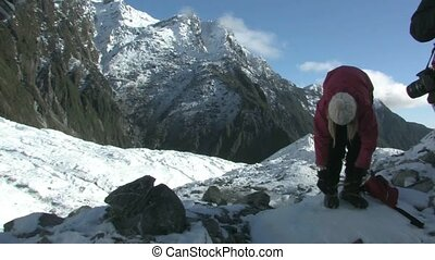 Girl putting on crampons - Young female putting on crampons...