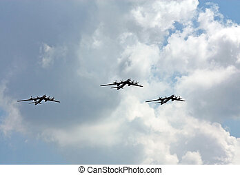 Russian strategic bombers in flight - Three bombers TU-95 in...
