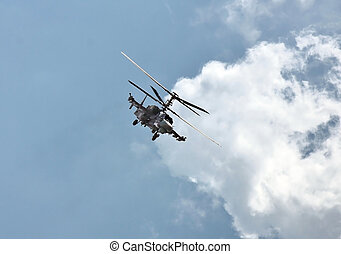 Combat helicopter in flight - Perform aerobatics by the...