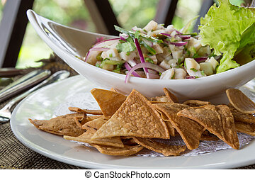 Ceviche with Nachos - Plate of Ceviche, a popular dish in...