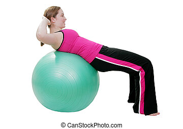 pilates sit up exercise - young woman exercising with green...