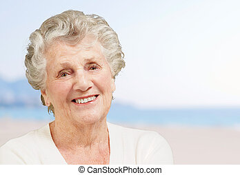 healthy senior woman smiling in the beach