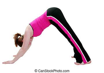 downward facing dog - young woman doing yoga pose and...